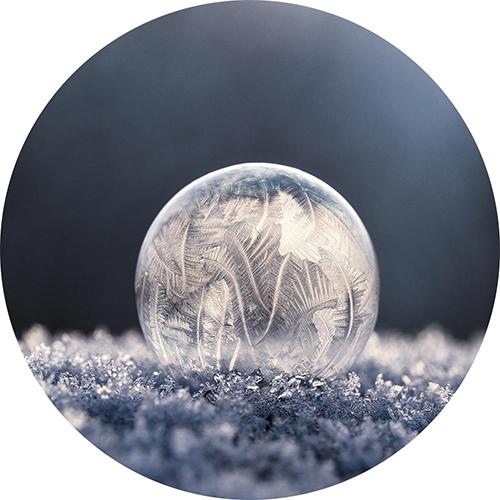 Ice crystal globe on stellar snow crystals