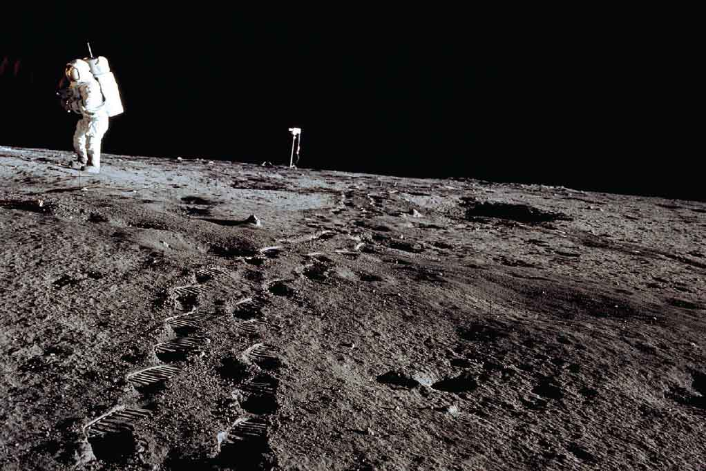 Astronaut Alan L. Bean walks from the moon-surface television camera toward the lunar module during the first extravehicular activity of the November 1969 Apollo 12 mission, the second lunar landing in the NASA Apollo program. Photo: NASA.