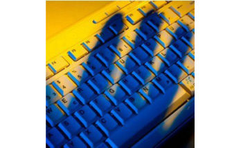 shadow of hand on keyboard - Credit: Lisa S / Shutterstock
