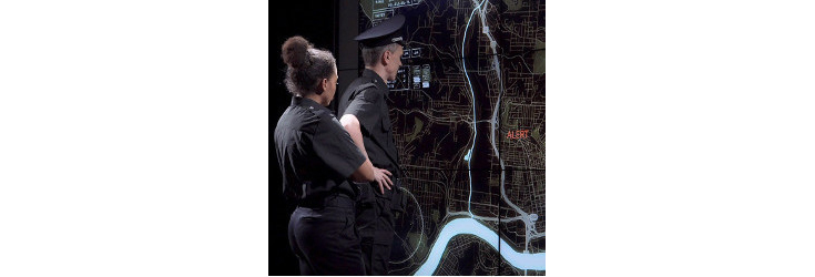 police officers examine wall-sized map display - Credit: Frame Stock Footages
