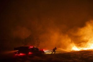 a firefighter extinguishing a fire - Photograph: Philip Pacheco/Bloomberg/Getty Images