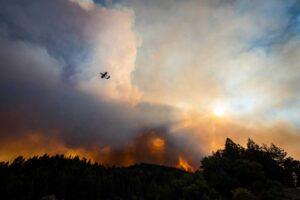 A Cal Fire air attack plane flies over the Walbridge Fire, near Healdsburg, Calif., on Thursday. (Stuart W. Palley for The Washington Post)