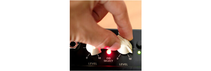 hand turning knobs on console - Credit: Getty Images