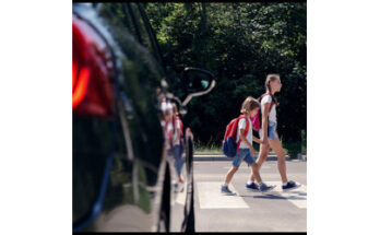 stopped vehicle and students in crosswalk - Credit: Photographee.eu