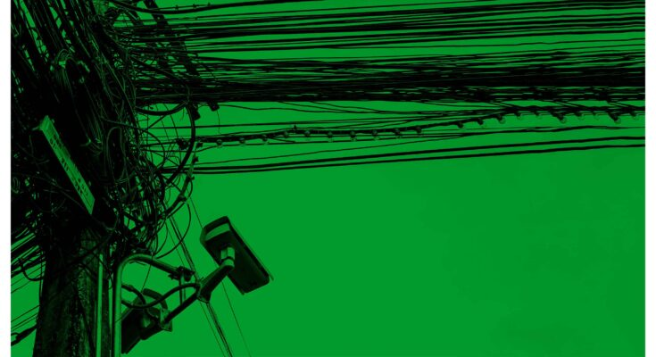 telephone pole with wires - Getty