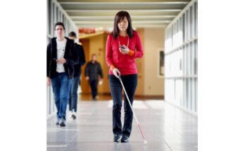 blind person navigating via smartphone app - Credit: The Associated Press