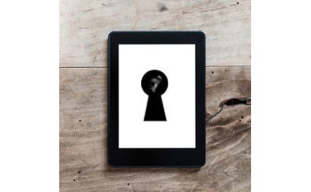 eye in keyhole on e-reader
