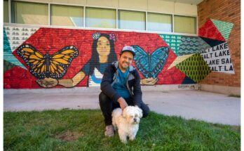 """(Rick Egan   The Salt Lake Tribune) Artist Jorge Arellano with his dog Grizzly, in front of the mural he painted at the SLC Center for Science Education, in Rose Park, which is part of the """"West of Conventional"""" Mural Tour, on Monday, Oct. 4, 2021."""