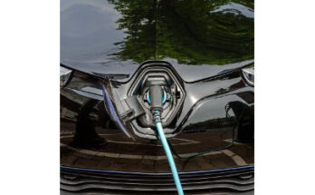 charging port on hood of electric vehicle - Credit: Andrii Malkov
