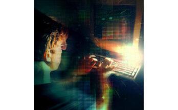 male at glowing keyboard - Credit: Andrij Borys Associates, Shutterstock